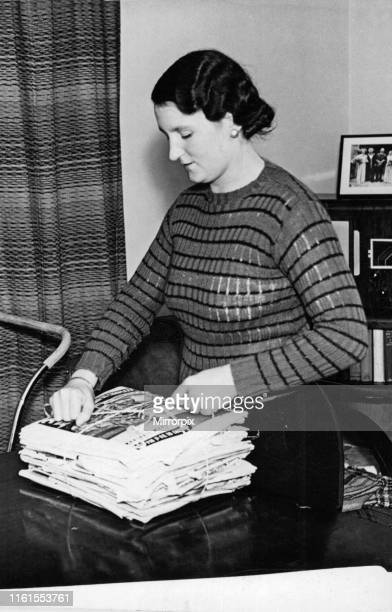 Housewife Baling waste paper into neat bundle in Derby 15th October 1939 Paper recycling was also important in the Second World War huge demands were...