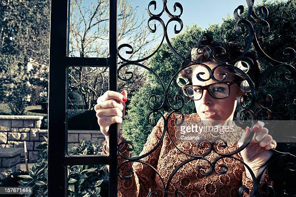 Housewife behind the entrance gate