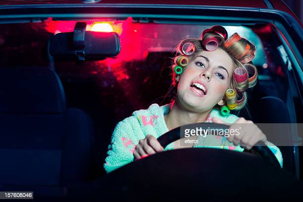 housewife driving a car - singing stock pictures, royalty-free photos & images