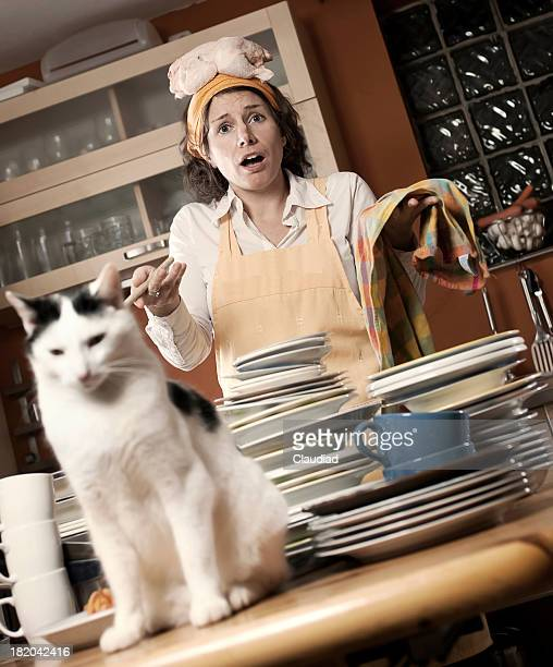 housewife has chaos in kitchen - beat your meat stock photos and pictures
