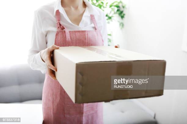 Housewife holding delivery box