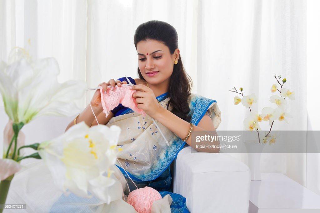 Housewife knitting : Stock Photo