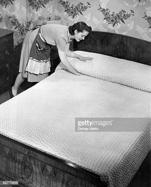 Housewife making bed