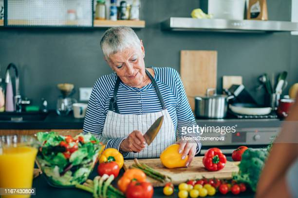 housewife preparing healthy food for the family - chopped stock pictures, royalty-free photos & images