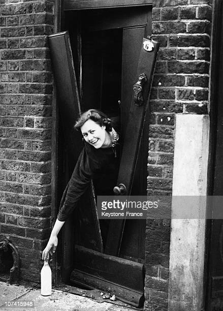 Housewife Reaching For Milk Through The Door In London On 1940