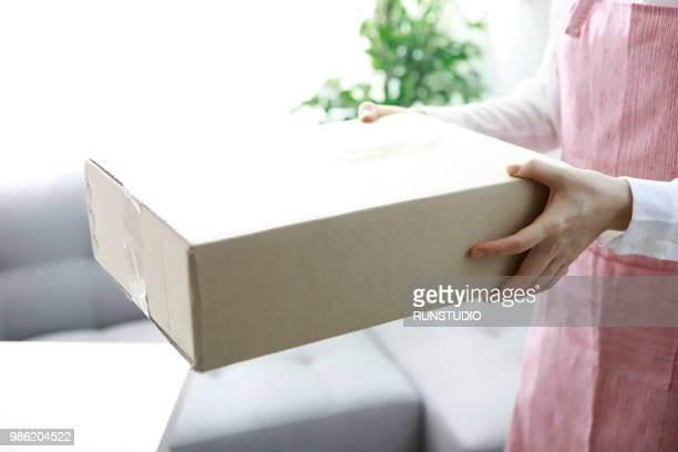 Housewife receiving package