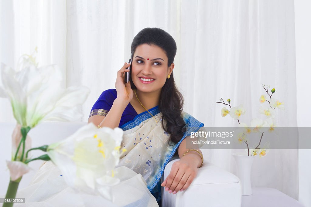 Housewife talking on a mobile phone : Stock Photo
