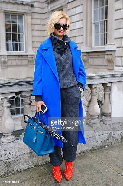 Housewife Tanya poses wearing a Stella McCartney jumpsuit with a Vintage Coat and Christian Louboutin shoes and a Hermes bag at Somerset House at...