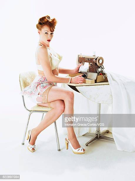 housewife using sewing machine - girdle stock photos and pictures