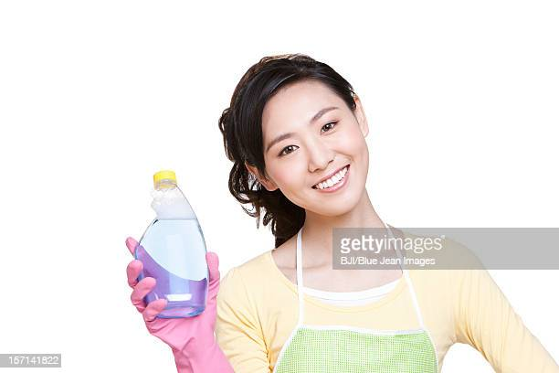 housewife with cleaning product - dishwashing liquid stock photos and pictures