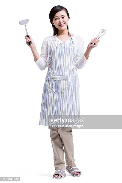 Housewife with cooking utensils