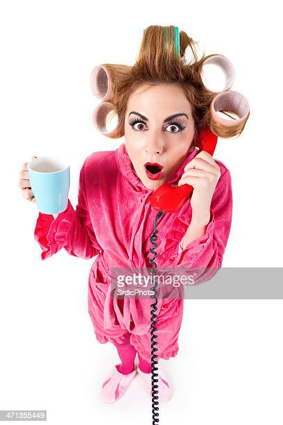 Housewife with curlers talking on phone isolated on white background