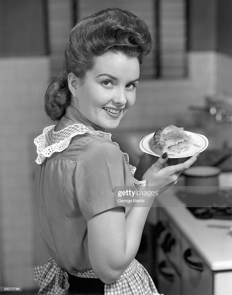 Housewife with dish of pie : Stock Photo