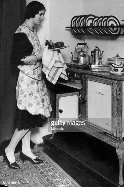 Housewife with her new Flecthers Queensday New World gas regulator oven and hob 19th April 1930