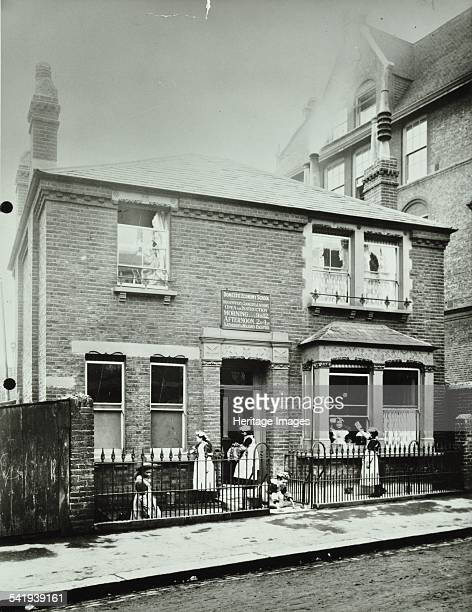 Housewifery Surrey Lane School Battersea London 1908 A group of girls are busy cleaning the outside of a house used as the domestic economy school...