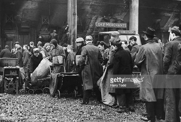 Housewives loading their prams ready to take away the week's coal supply at the Nine Elms depot of the Gas Light and Coke Company in London 18th...