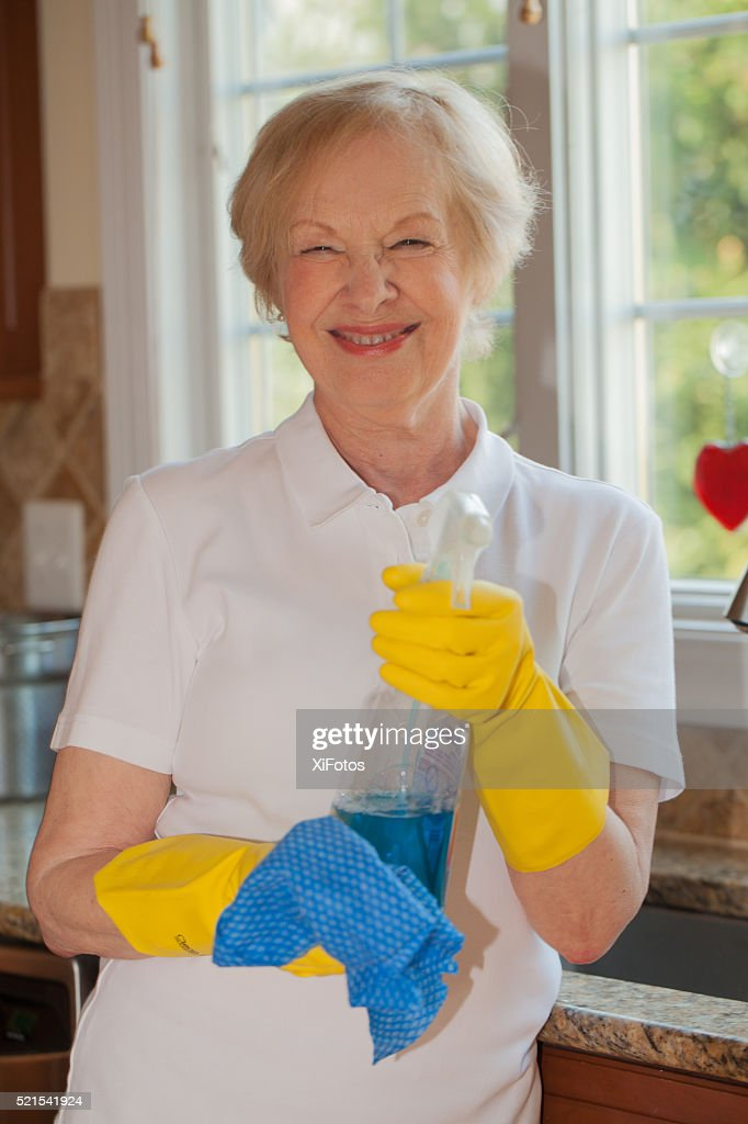 Housework: A Senior Woman Getting Ready To Clean Her Kitchen : Stock Photo