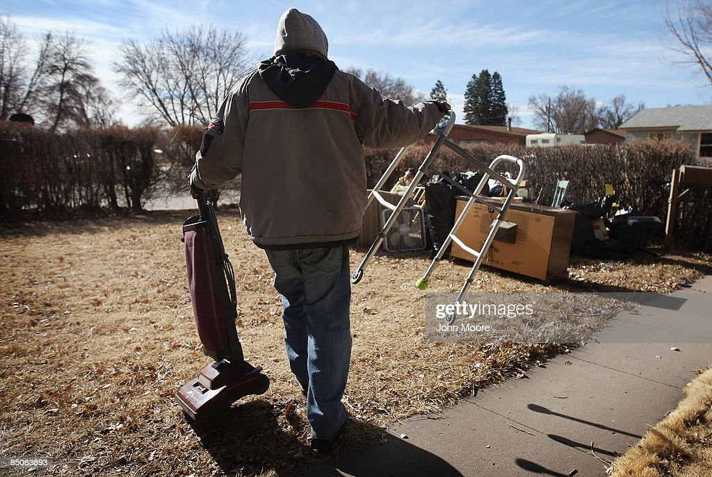 Houshold items of a deceased resident are put out on the front lawn of a foreclosed house February 25, 2009 in Security, Colorado. The elderly resident of the home died last year, and her family had stopped making the mortage payments. The bank took over the property and an eviction team moved out all the furnature Wednesday.