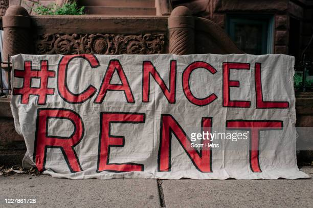 Housing activists gather to protest alleged tenant harassment by a landlord and call for cancellation of rent in the Crown Heights neighborhood on...