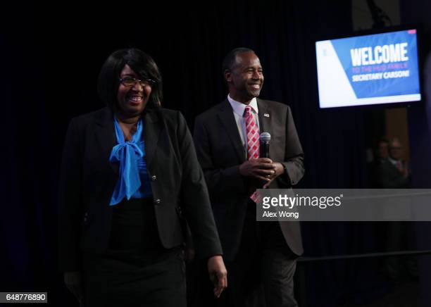 S Housing and Urban Development Secretary Ben Carson and his wife Candy Carson walk on stage prior to his address to his employees March 6 2017 in...