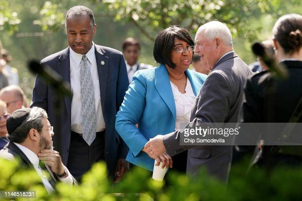 Housing and Urban Development Secretary Ben Carson his wife Candy Carson and Agriculture Secretary Sonny Perdue greet one another during a National...