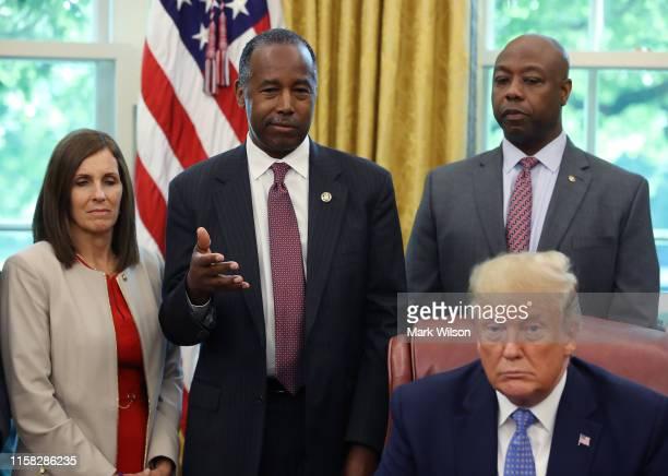 Housing and Urban Development Secretary Ben Carson speaks before U.S. President Donald Trump signed an executive order establishing a White House...