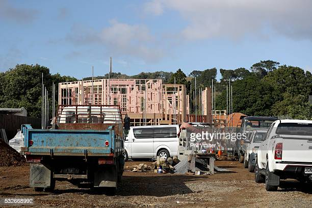 Housing construction is pictured with One Tree Hill in the background on May 19 2016 in Auckland New Zealand The budget due to be announced by Bill...