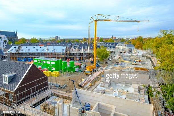 housing construction of newly built homes on a construction site in the city of zwolle in the netherlands. - zwolle stock pictures, royalty-free photos & images