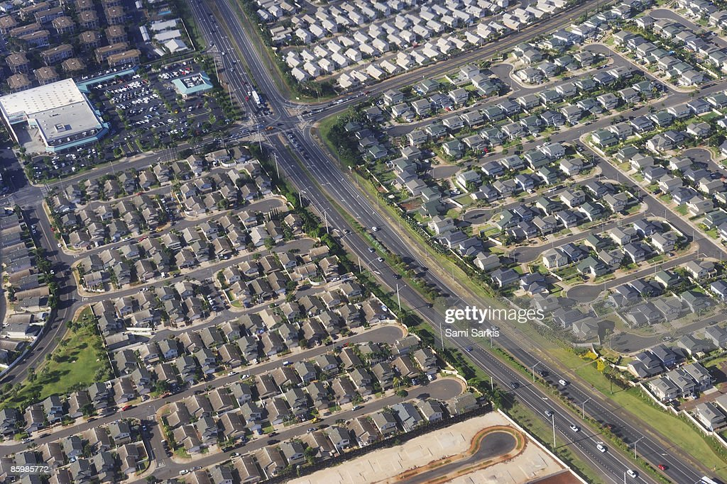 Housing development and highways, aerial view : Stock Photo