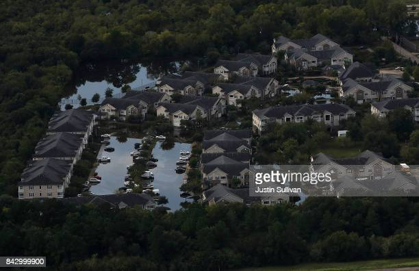 A housing development sits in floodwaters on September 5 2017 in Houston Texas Over a week after Hurricane Harvey hit Southern Texas residents are...