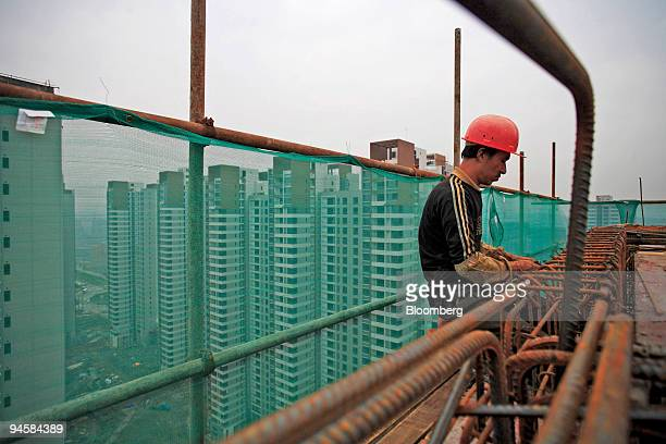 Housing developments rise in the skyline as construction work takes place in Chongqing China on Wednesday Oct 17 2007 Chongqing a municipality as...