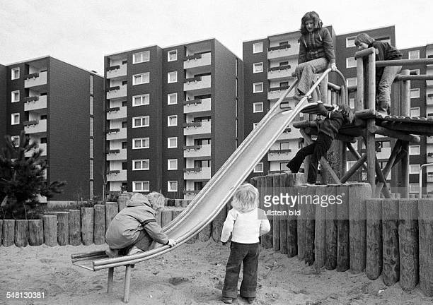 housing estate apartment blocks tower buildings childrens playground children girls aged 3 to 6 years DOberhausen DOberhausenSterkrade Ruhr area...