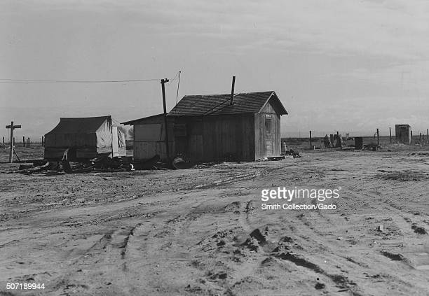 Housing for refugees of the Oklahoma dustbowl, California, 1936. From the New York Public Library. .