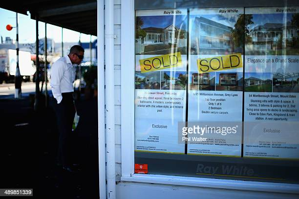 Housing for sale is displayed on an real estate office shop window on May 13 2014 in Auckland New Zealand Finance Minister Bill English will deliver...