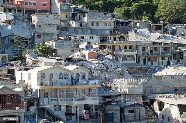 Housing is left in ruins in Morne Saint Lazare Delmas January 14 2010 in PortauPrince Haiti Planeloads of rescuers and relief supplies headed to...