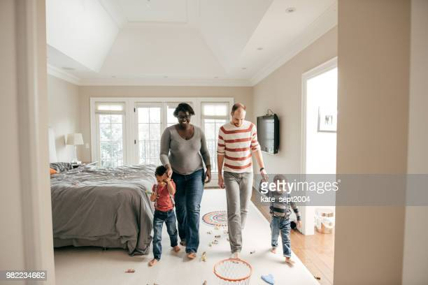 housing loan procedure - white wife black baby stock photos and pictures