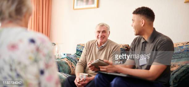 housing officer with clients - community care stock pictures, royalty-free photos & images