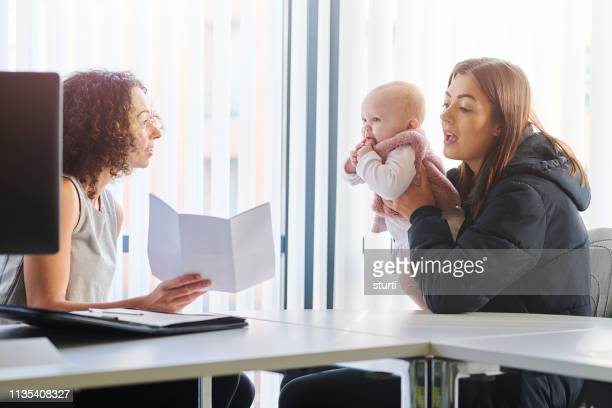 housing officer with young mum - politics stock pictures, royalty-free photos & images
