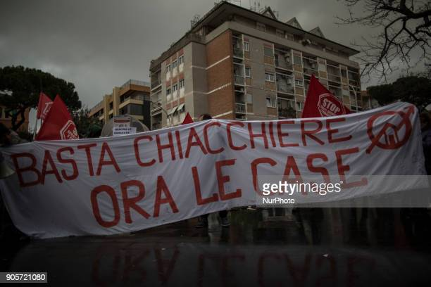 'Housing rights' activists hold a banner reading 'Enough talk now the houses' during a demonstration to protest against forced housing evictions in...