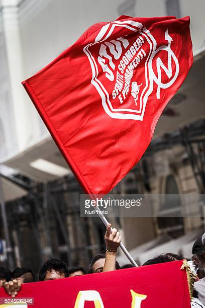 Housing rights activists wave flags as they take part in a demonstration to protest against forced housing evictions in Rome Hundreds of housing...