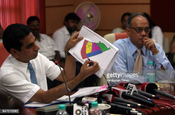 Housing Slum Rehabilation IS Chahal and Mukesh Metha address the media during a press conference to announce the Dharavi Redevelopmet Project at...