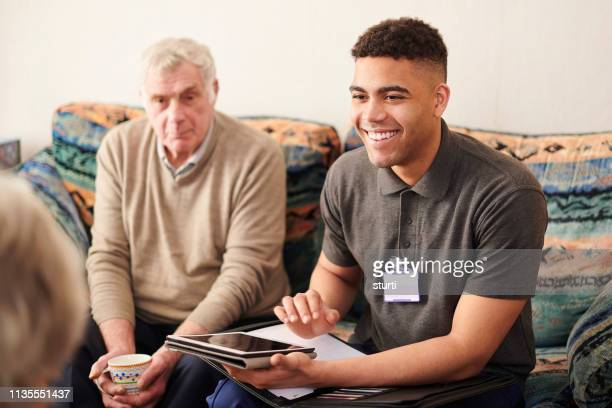 housing support worker with clients - social services stock pictures, royalty-free photos & images