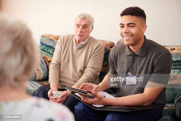 housing support worker with clients - social worker stock pictures, royalty-free photos & images