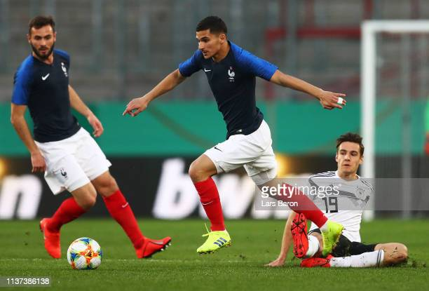 Houssem Aouar of France is challenged by Florian Neuhaus of Germany during the Germany U21 v France U21 International Friendly match on March 21 2019...