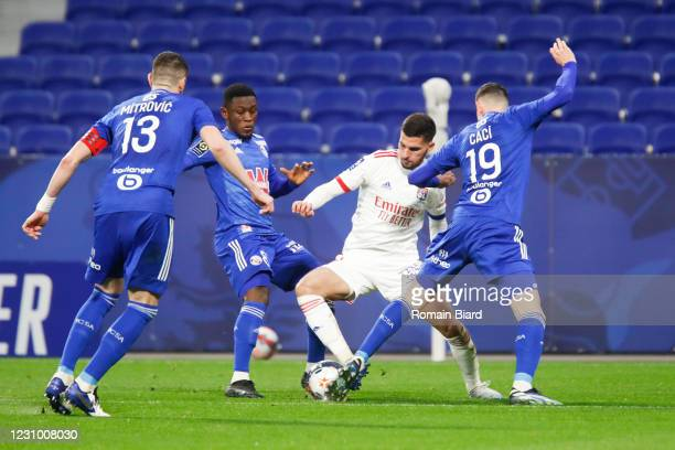 Houssem AOUAR of Lyon and Anthony CACI of Strasbourg and Stefan MITROVIC of Strasbourg and Majeed WARIS of Strasbourg during the Ligue 1 soccer match...