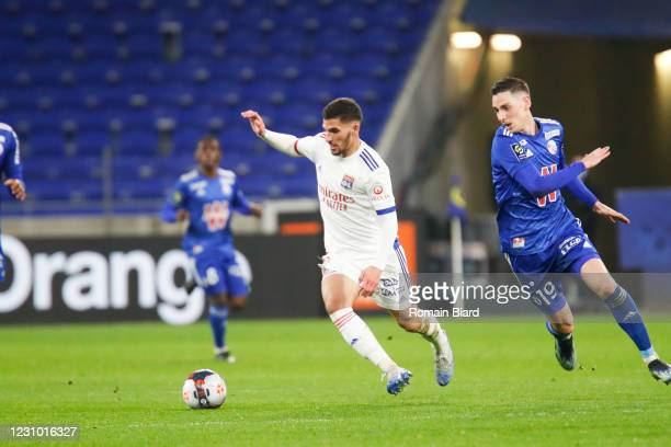 Houssem AOUAR of Lyon and Anthony CACI of Strasbourg during the Ligue 1 soccer match between Olympique Lyonnais and Strasbourg at Groupama Stadium on...