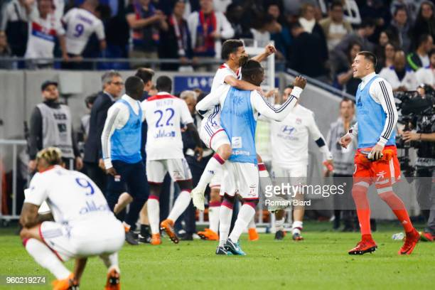 Houssem Aouar of Lyon and Anthony Racioppi of Lyon and Mariano Diaz of Lyon celebrate the qualification for the next Champions League during the...