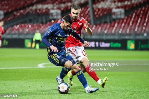 Houssem Aouar of Lyon and Brendan Chardonnet of Brest during the Ligue 1 soccer match between Stade Brestois 29 and Olympique Lyonnais at Francis-Le...