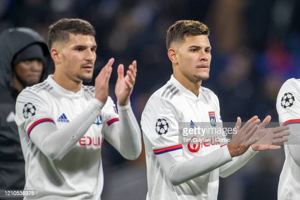 Houssem Aouar of Lyon and Bruno Guimaraes of Lyon applaud the fans after the teams victory during the Lyon V Juventus UEFA Champions League Round of...