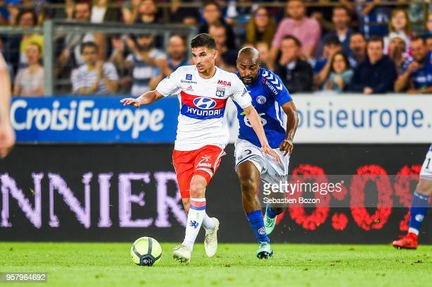 Houssem Aouar of Lyon and Dimitri Foulquier of Strasbourg during the Ligue 1 match between Strasbourg and Olympique Lyonnais on May 12 2018 in...